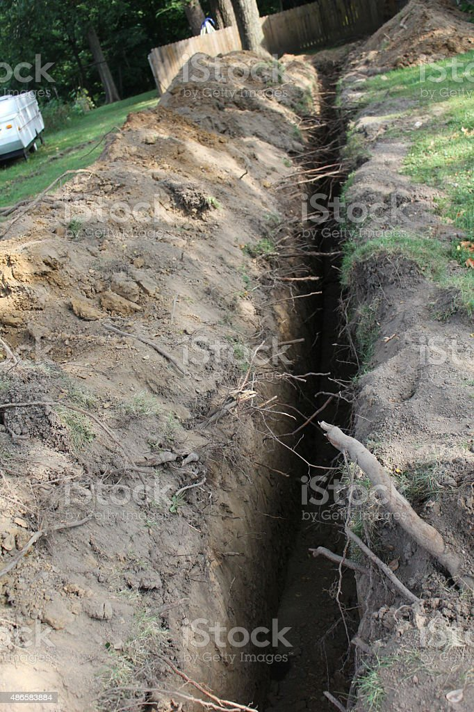 Putting in a resedential water line stock photo