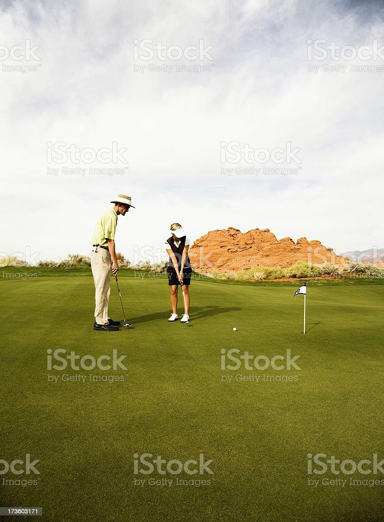 Putting Instruction royalty-free stock photo