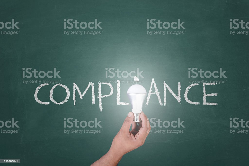 Putting light on compliance stock photo