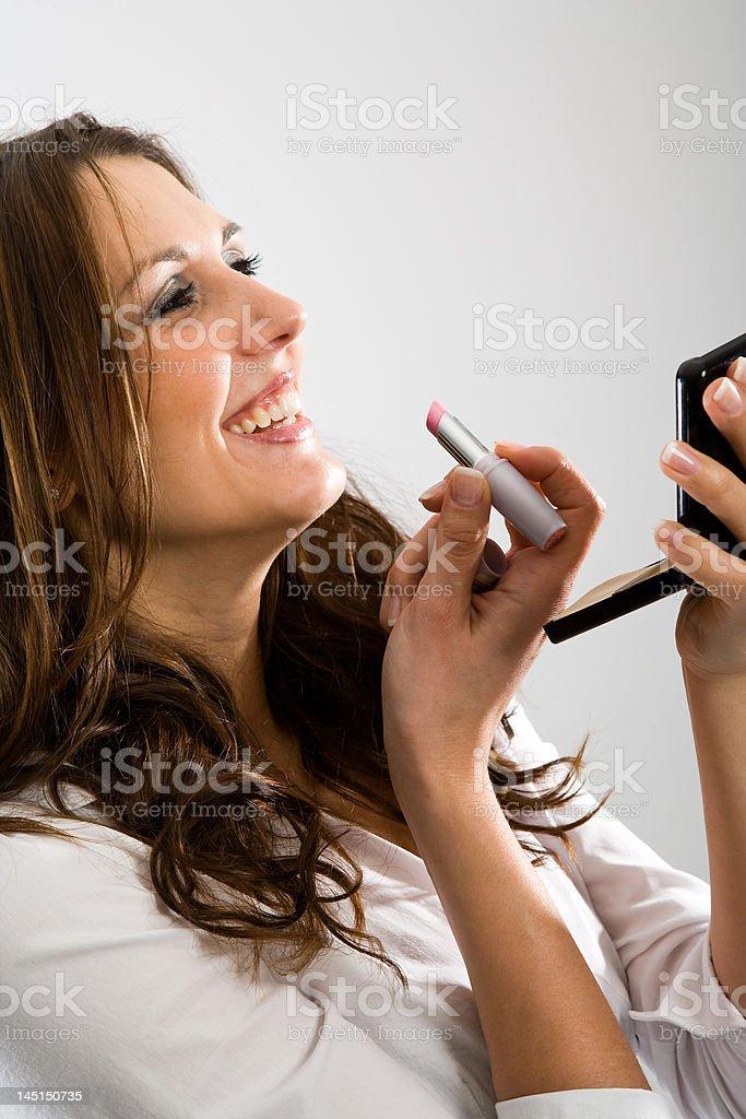 Putting makeup on with fun stock photo