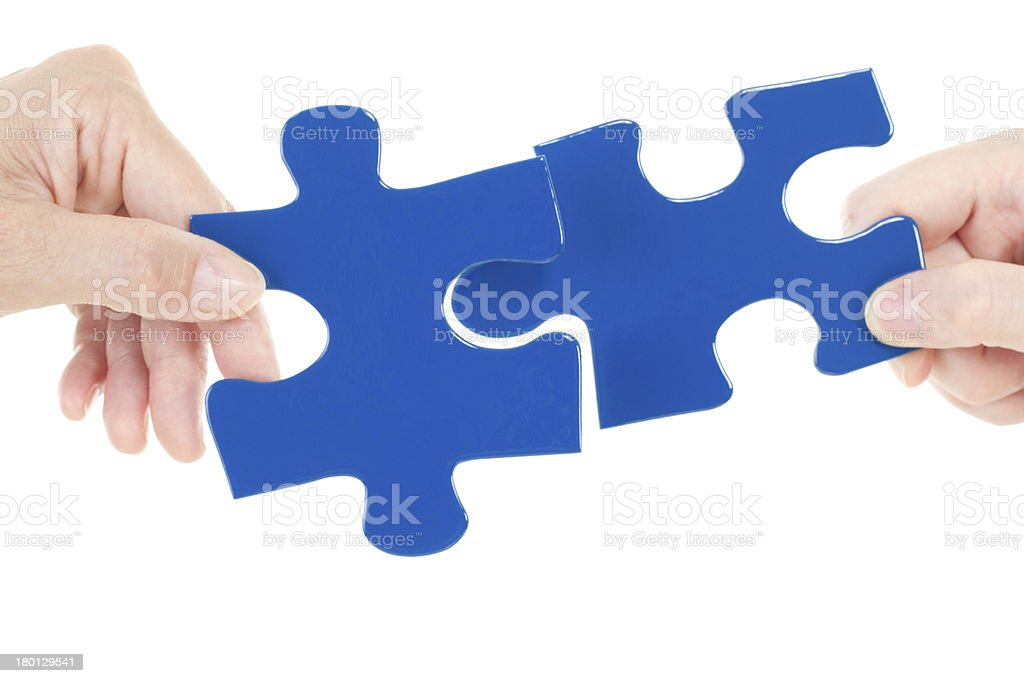 Putting next pieces together for solving jigsaw stock photo
