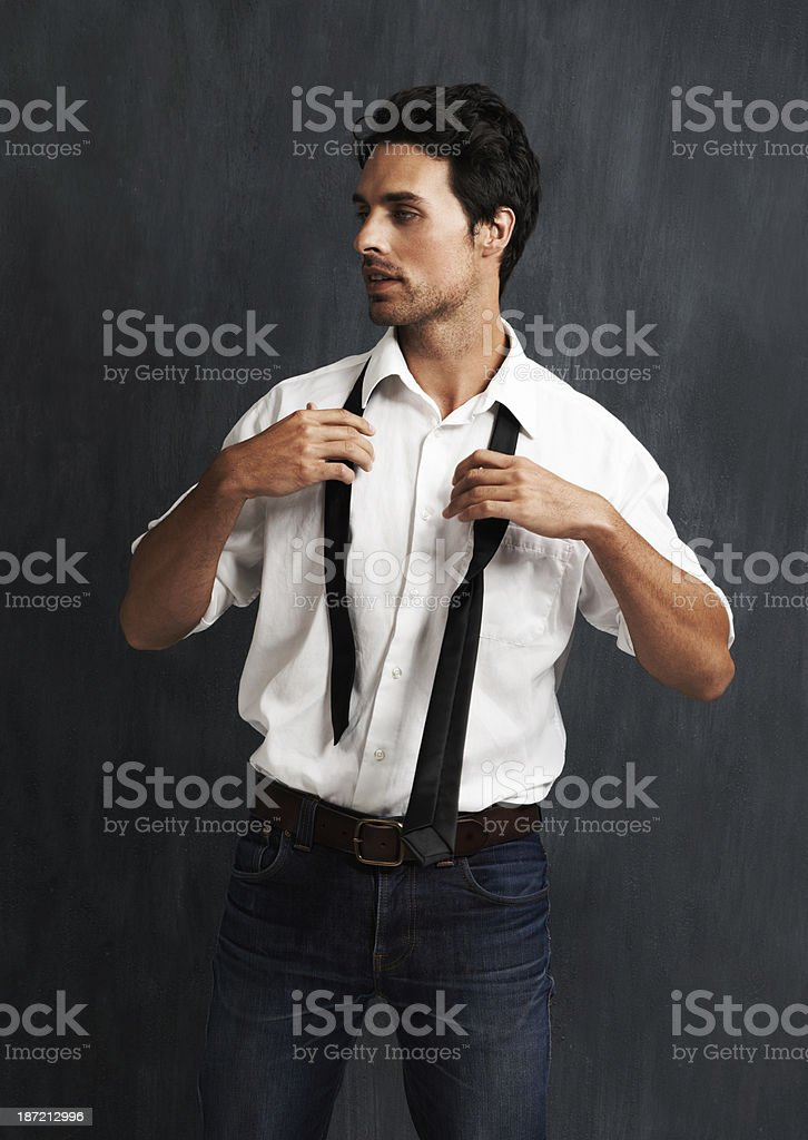 Putting on a tie stock photo