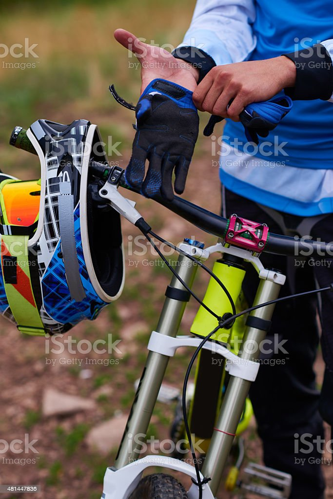 Putting on cycling gloves stock photo