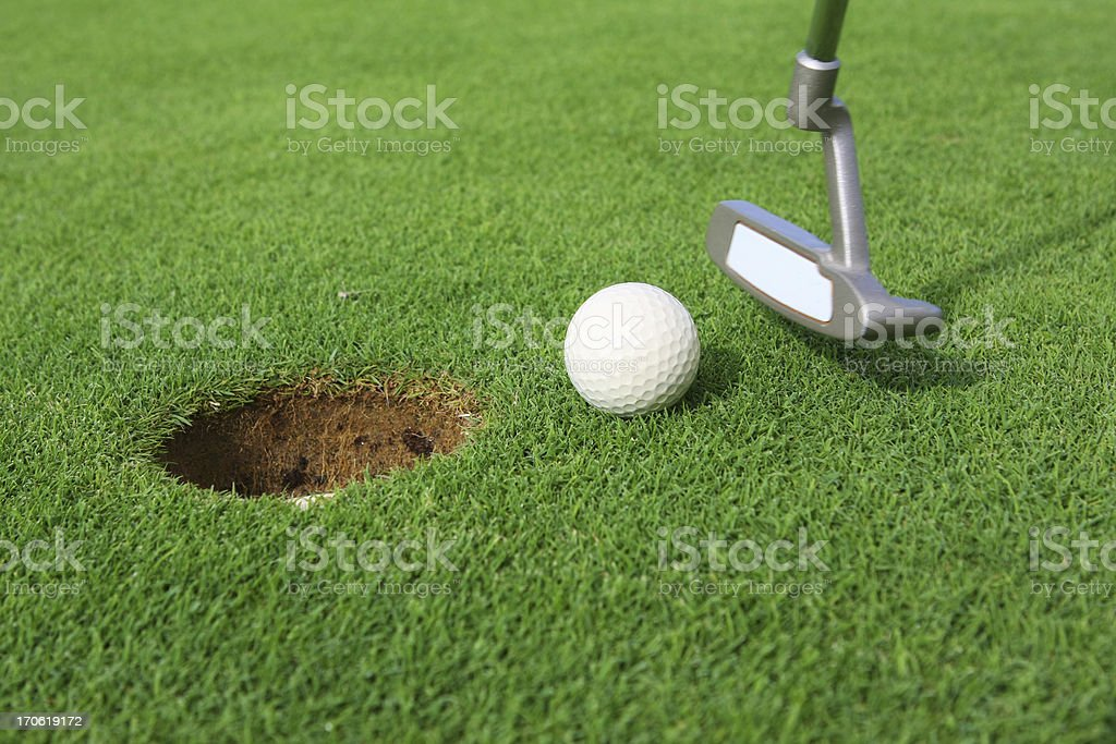 Putting on green...golf course