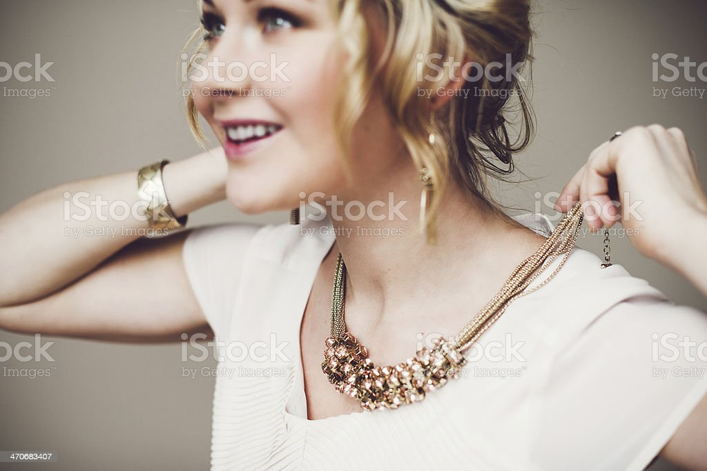 Putting on jewelry stock photo