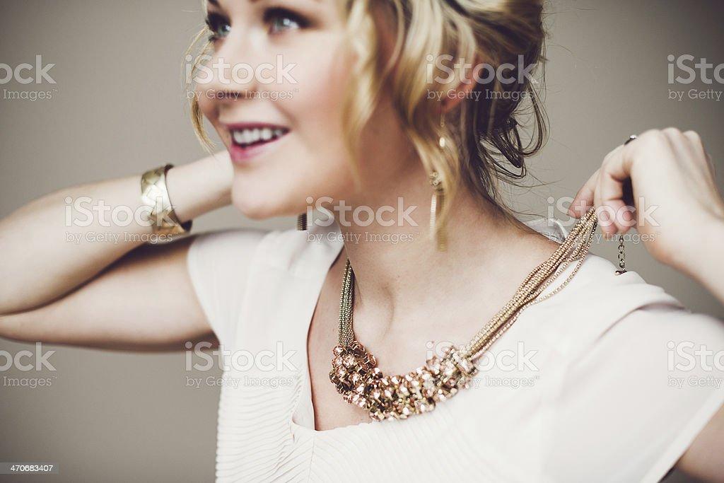 Putting on jewelry stock photo