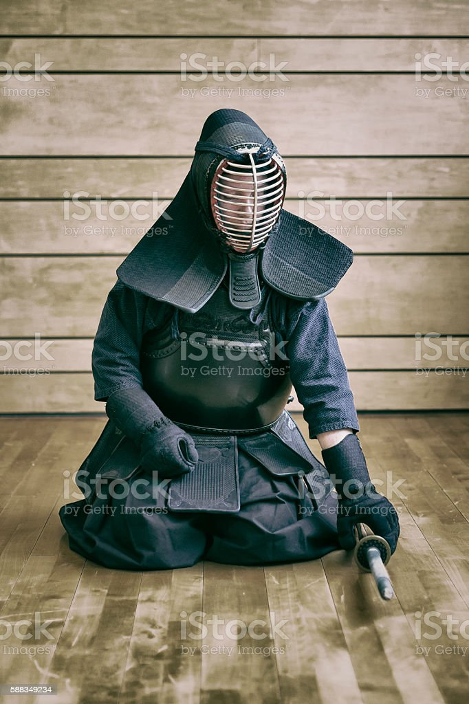 Putting on Kendo gear stock photo