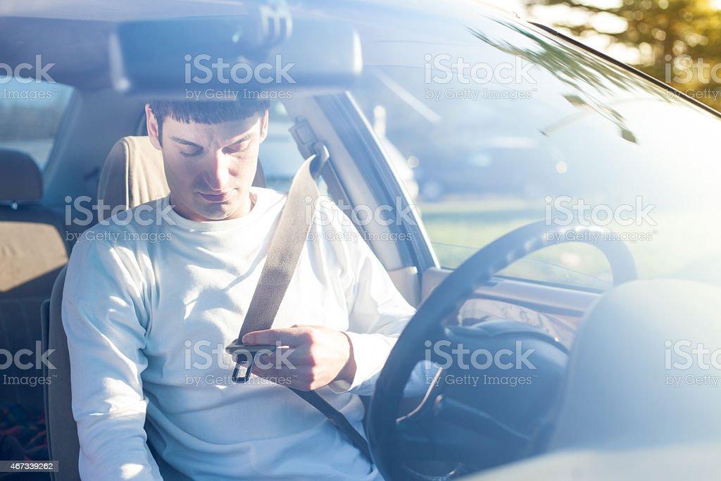 putting on seat belt stock photo