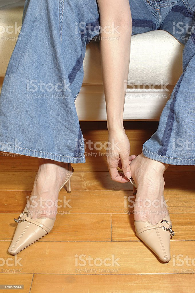 putting on shoes royalty-free stock photo