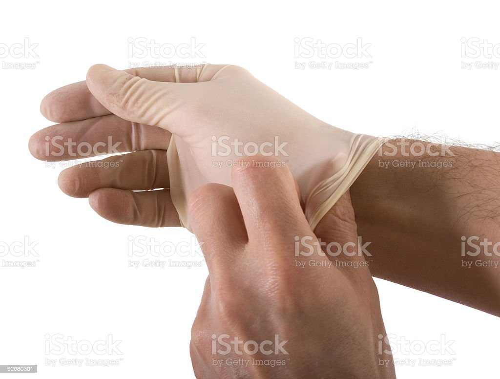 Putting on surgical glove royalty-free stock photo