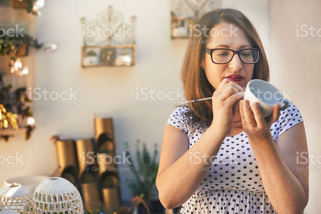 Putting on the finishing touches stock photo