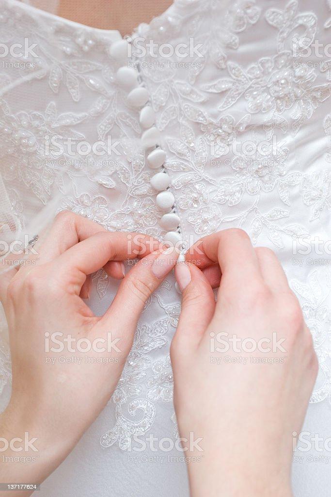 putting on wedding dress royalty-free stock photo