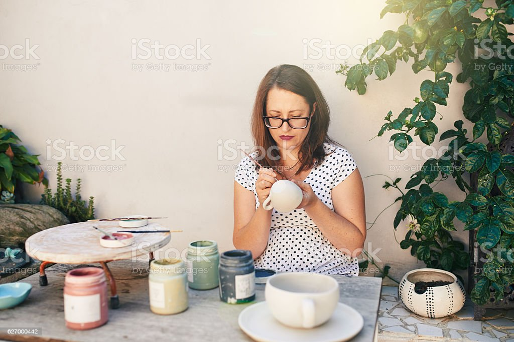 Putting one her personal touches stock photo