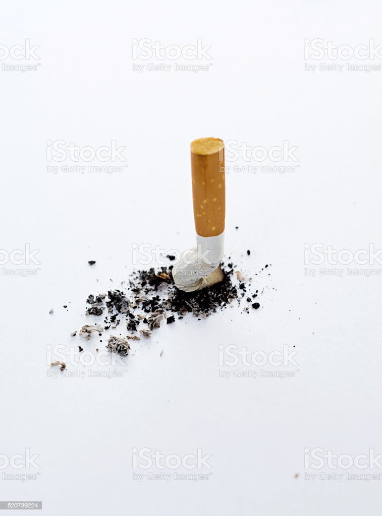 Putting out a cigarette stock photo