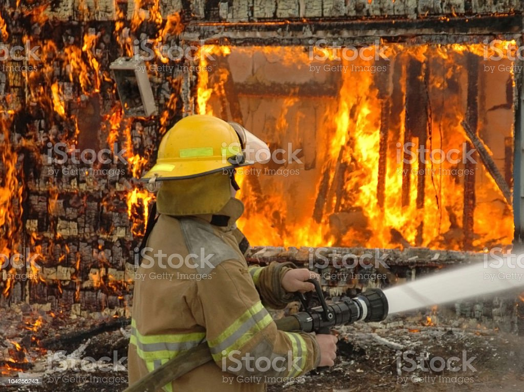 Putting out the Flames stock photo