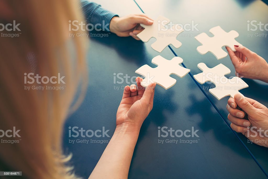 Putting Puzzles Together stock photo
