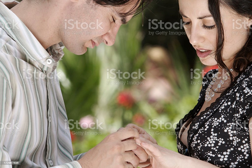 Putting ring on finger stock photo