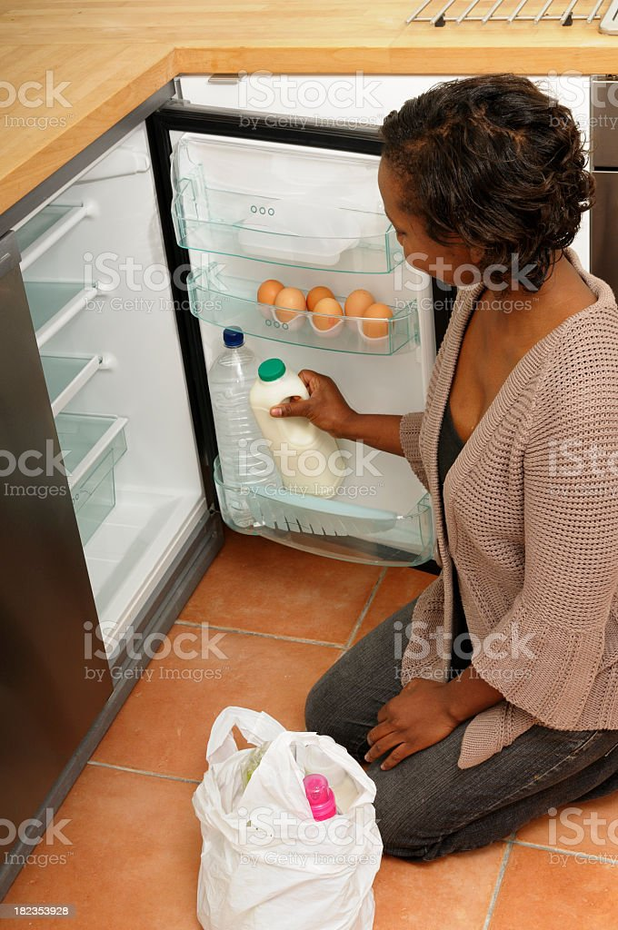 Putting Shopping in the Refrigerator stock photo