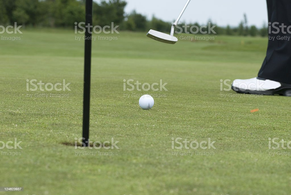 Putting shot golf ball hit by club royalty-free stock photo