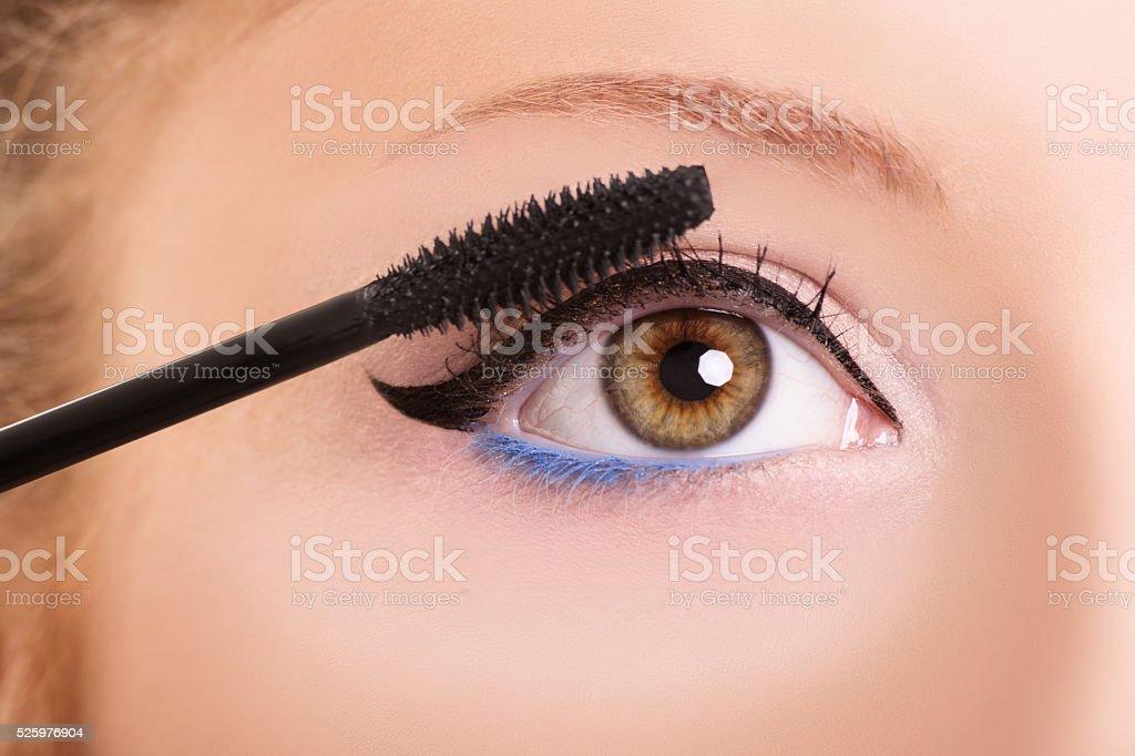 Putting some mascara on stock photo