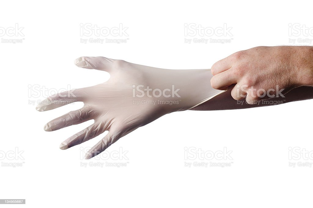 Putting surgical glove on royalty-free stock photo