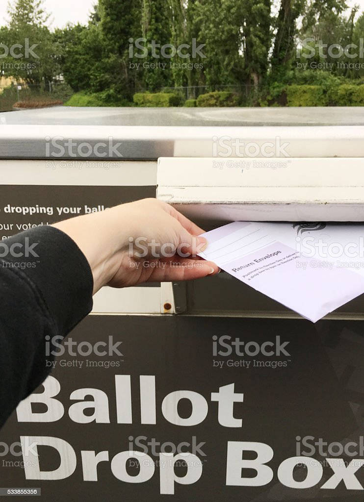 Putting The Ballot In the Box stock photo