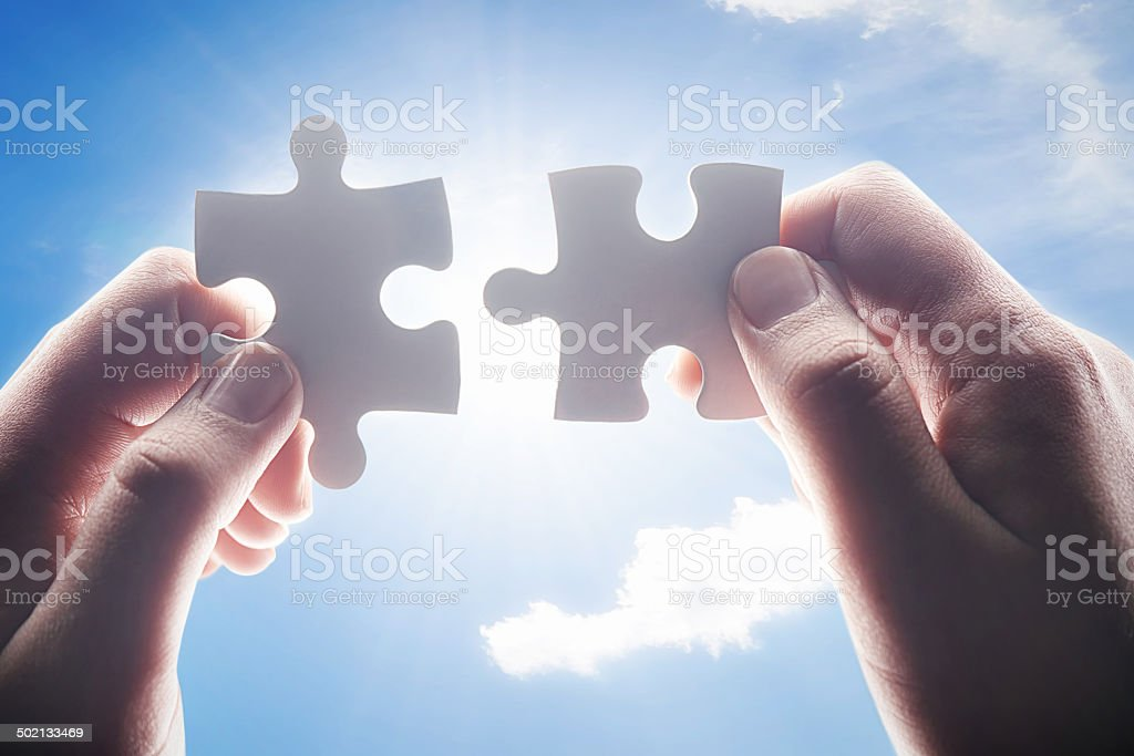 Putting the final pieces together royalty-free stock photo
