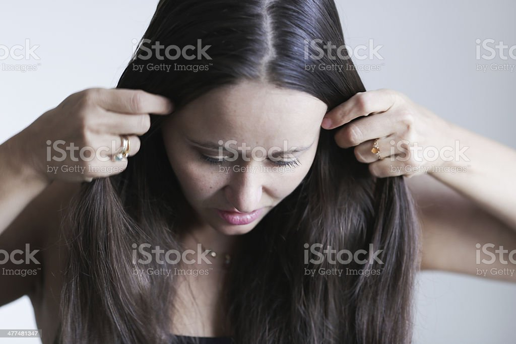 Putting the hair stock photo