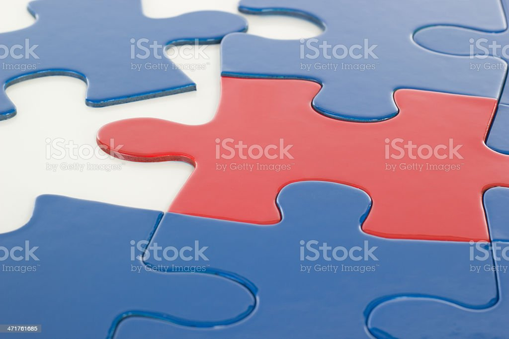 Putting the jigsaw puzzle in teamwork together royalty-free stock photo