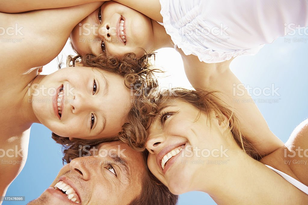 Putting their heads together - Family fun royalty-free stock photo