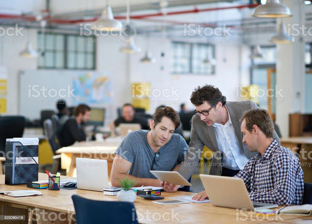 Putting their heads together for an awesome design stock photo