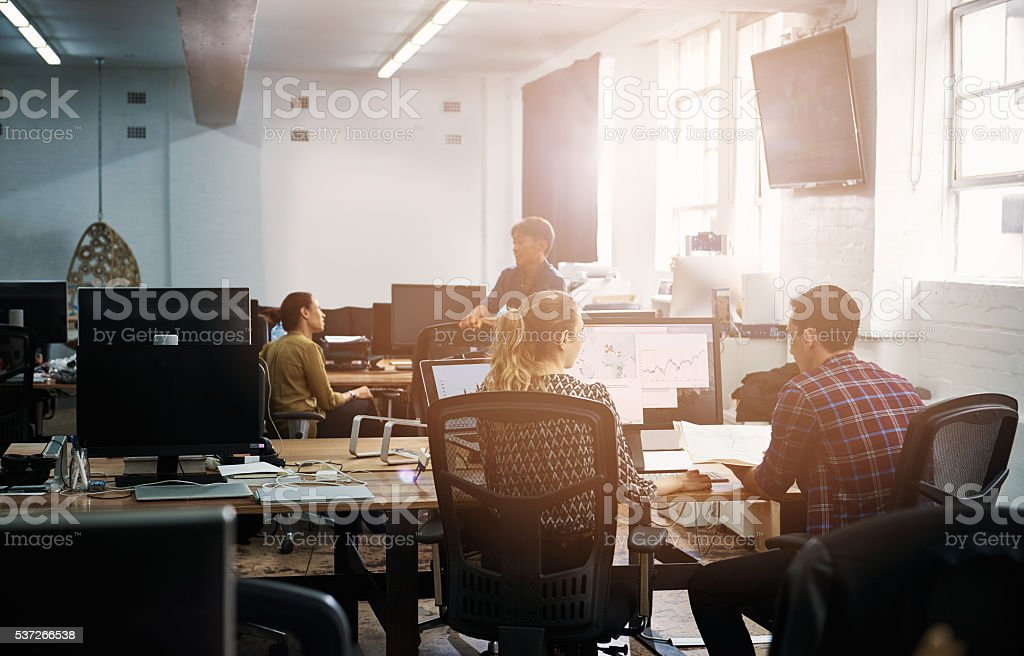Putting their heads together to boost productivity stock photo