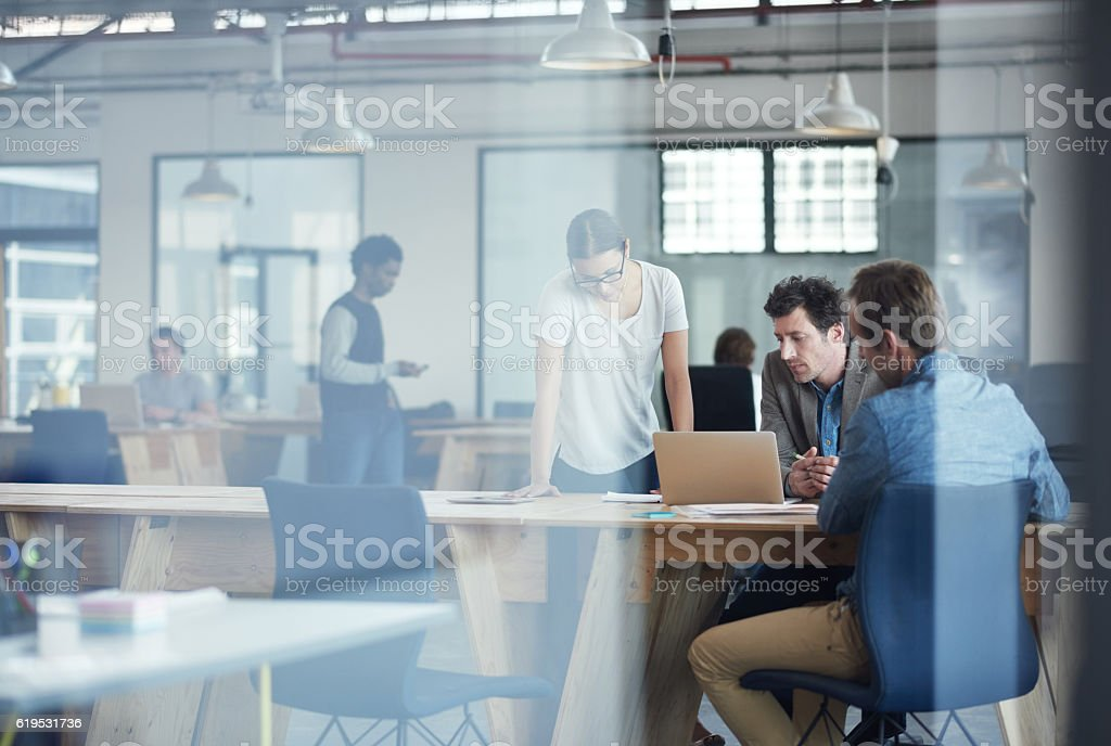 Putting there heads together on the project stock photo