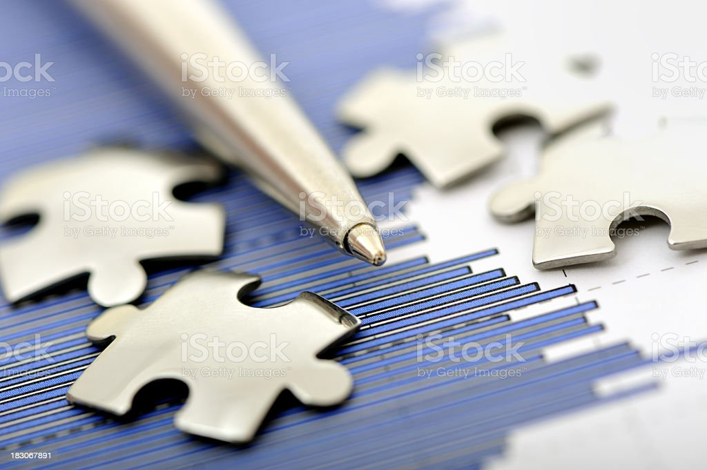 Putting together puzzle pieces and facts to solve a problem royalty-free stock photo