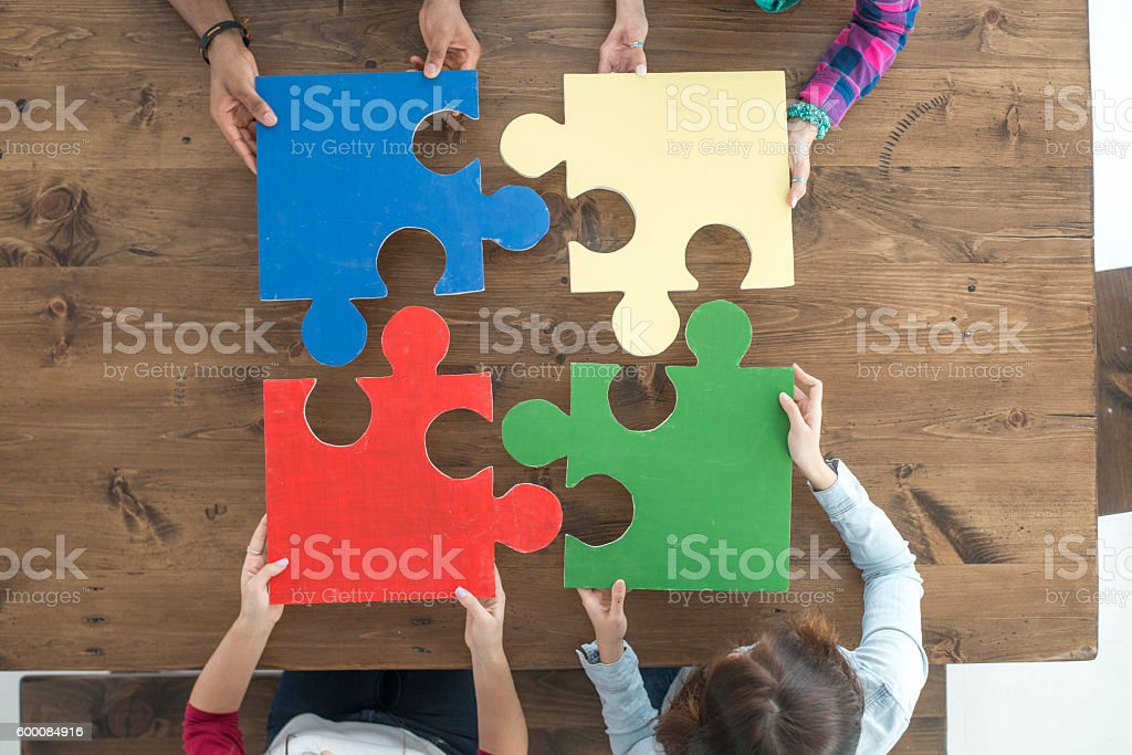 Putting Together Puzzle Pieces stock photo