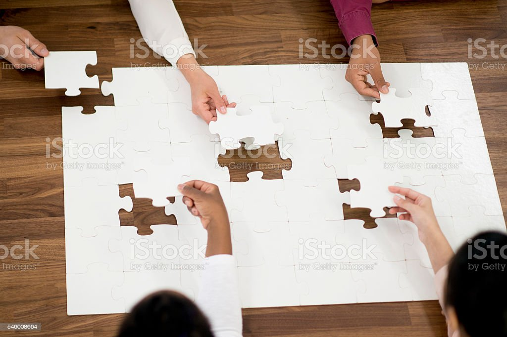 Putting Together the Final Pieces of the Puzzle stock photo