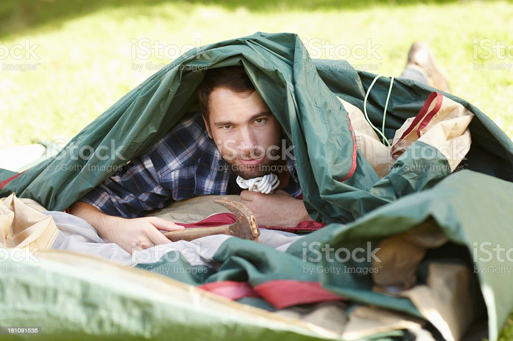 Putting up a tent is tricker than I thought! stock photo