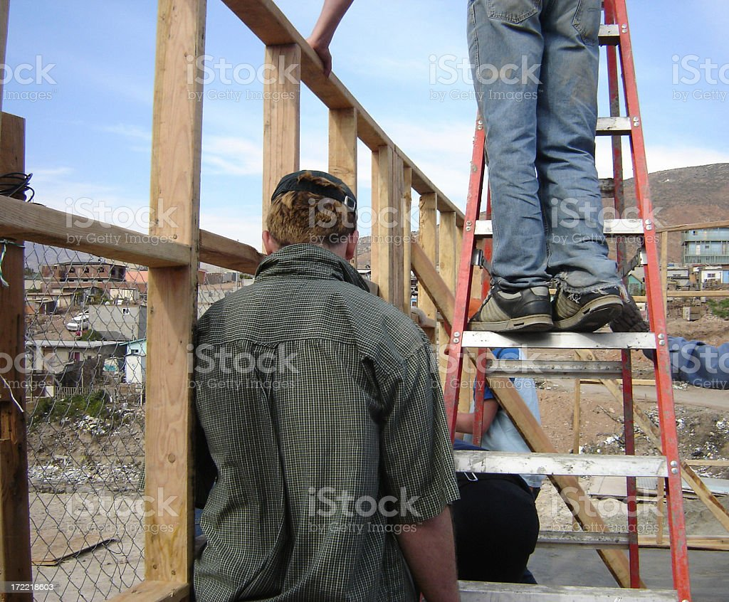 Putting up the Wall royalty-free stock photo