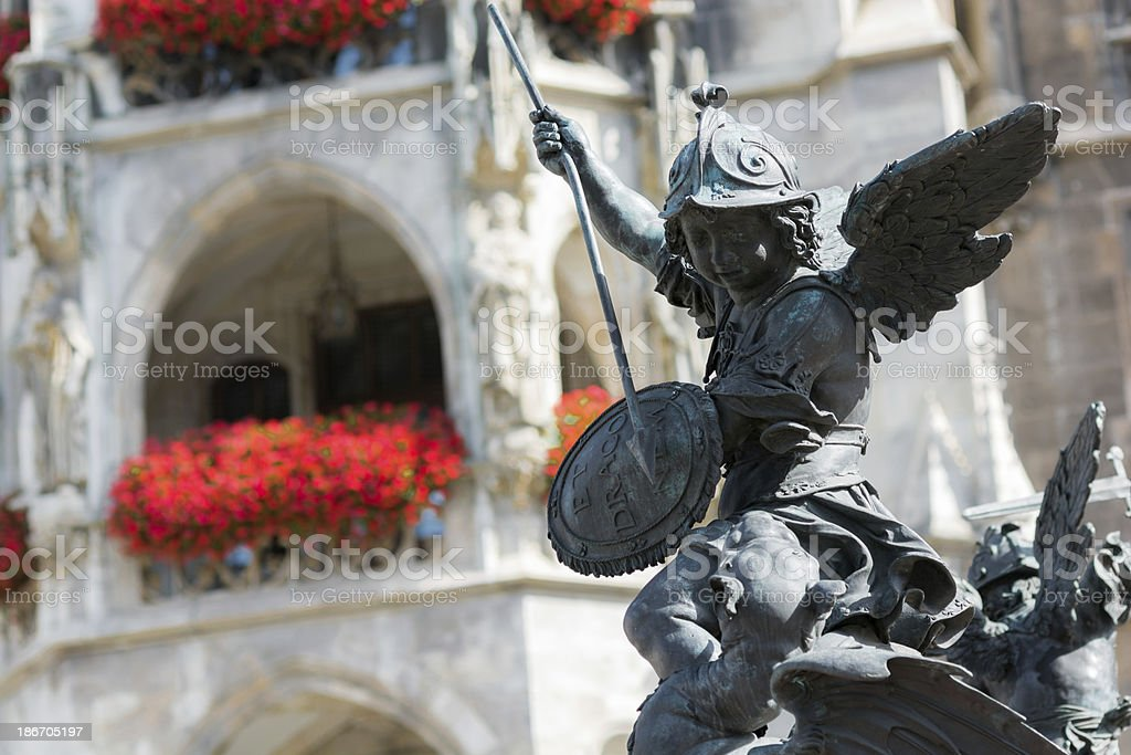 Putto statue at base of Mariens?ule in Munich, Germany royalty-free stock photo