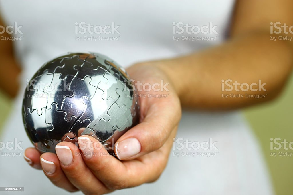 Puzzle globe in hand stock photo