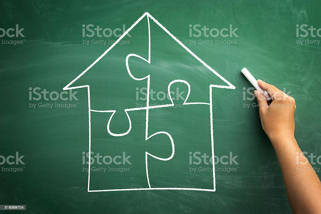 Puzzle house stock photo