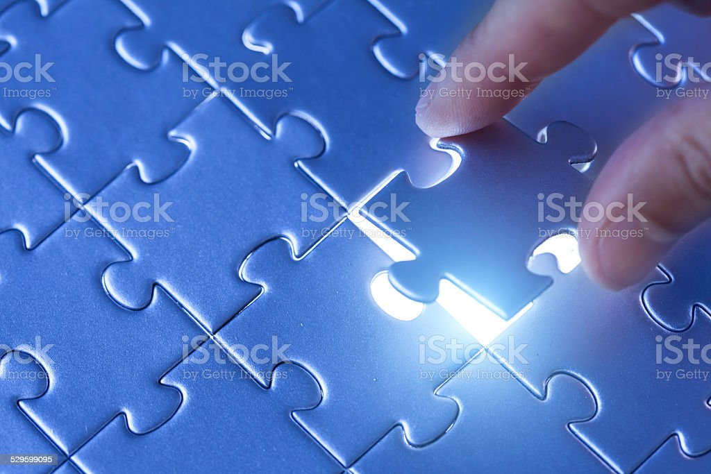 Puzzle in blue stock photo