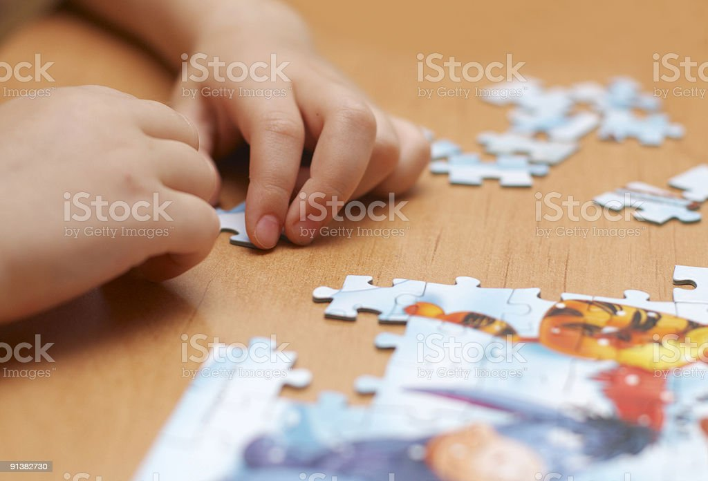puzzle in kid hands stock photo