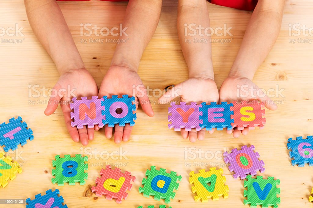 puzzle letters yes and no stock photo