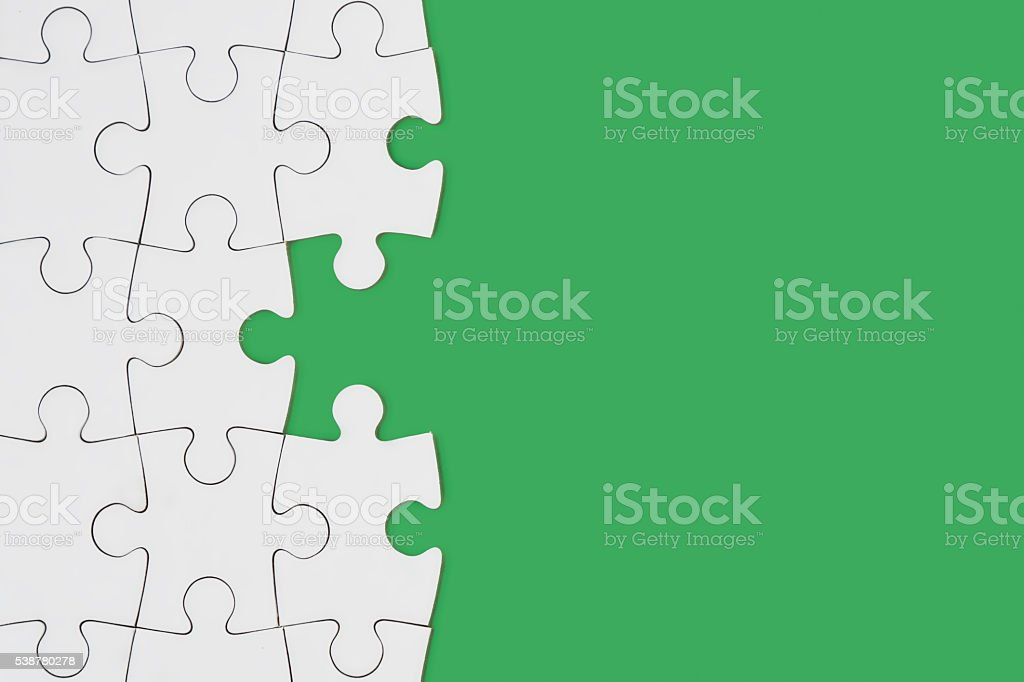 Puzzle on green stock photo