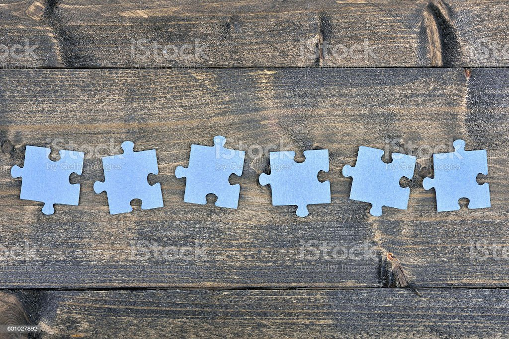 Puzzle on wooden table stock photo