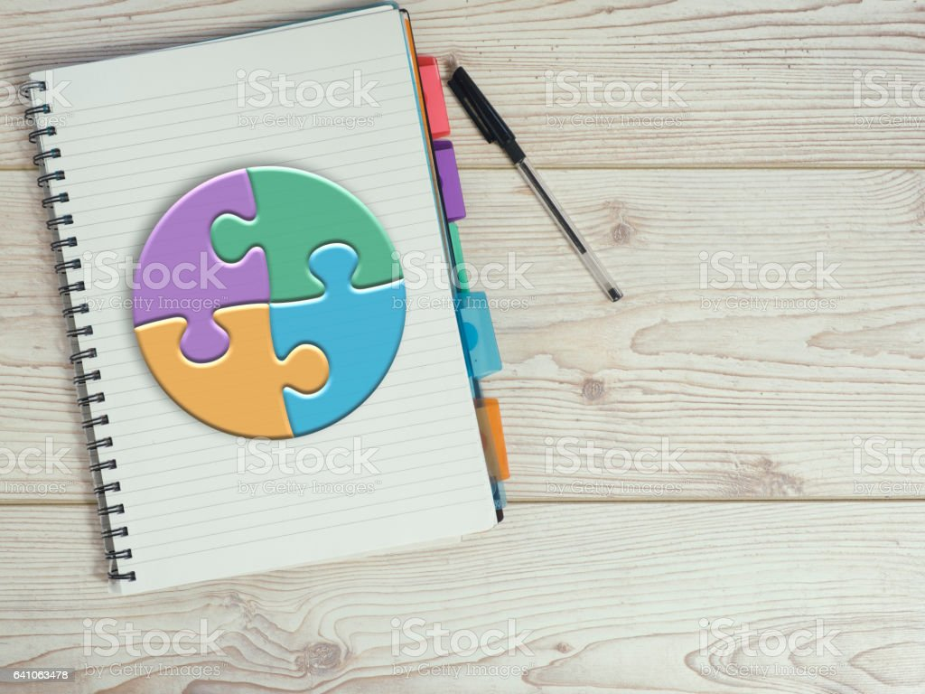 puzzle pie chart on desk stock photo