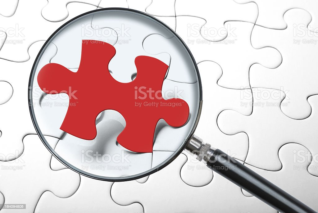 Puzzle Piece with magnifying glass royalty-free stock photo