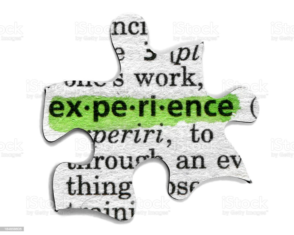 A puzzle piece with the word experience highlighted in green stock photo