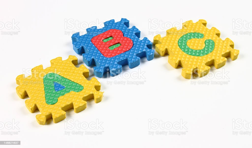 Puzzle pieces of alphabets royalty-free stock photo